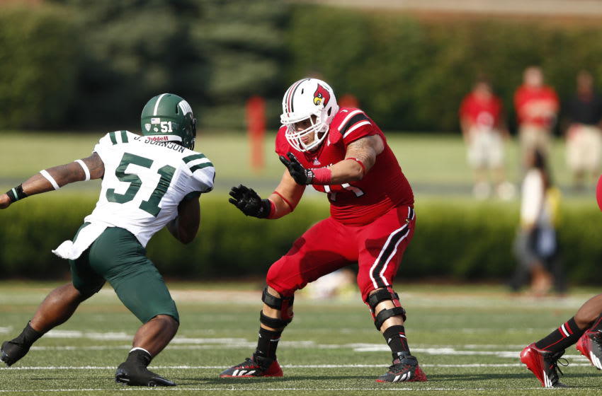 LOUISVILLE, KY - SEPTEMBER 1: Chris Acosta #71 of the Louisville Cardinals blocks against the Ohio Bobcats during the game at Papa John's Cardinal Stadium on September 1, 2013 in Louisville, Kentucky. Louisville won 49-7. (Photo by Joe Robbins/Getty Images)