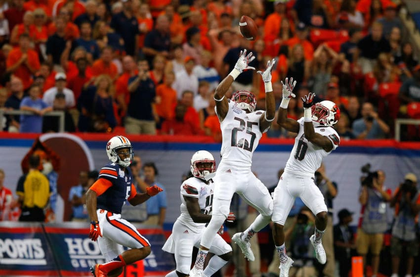ATLANTA, GA - SEPTEMBER 05: Josh Harvey-Clemons #25 of the Louisville football program intercepts this pass intended for Ricardo Louis #5 of the Auburn Tigers at Georgia Dome on September 5, 2015 in Atlanta, Georgia. (Photo by Kevin C. Cox/Getty Images)