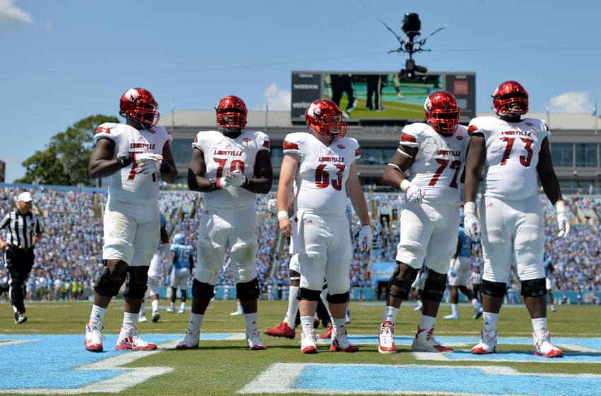 CHAPEL HILL, NC - SEPTEMBER 09: The Louisville Cardinals offensive line during the game against the North Carolina Tar Heels at Kenan Stadium on September 9, 2017 in Chapel Hill, North Carolina. Louisville won 47-35. (Photo by Grant Halverson/Getty Images)
