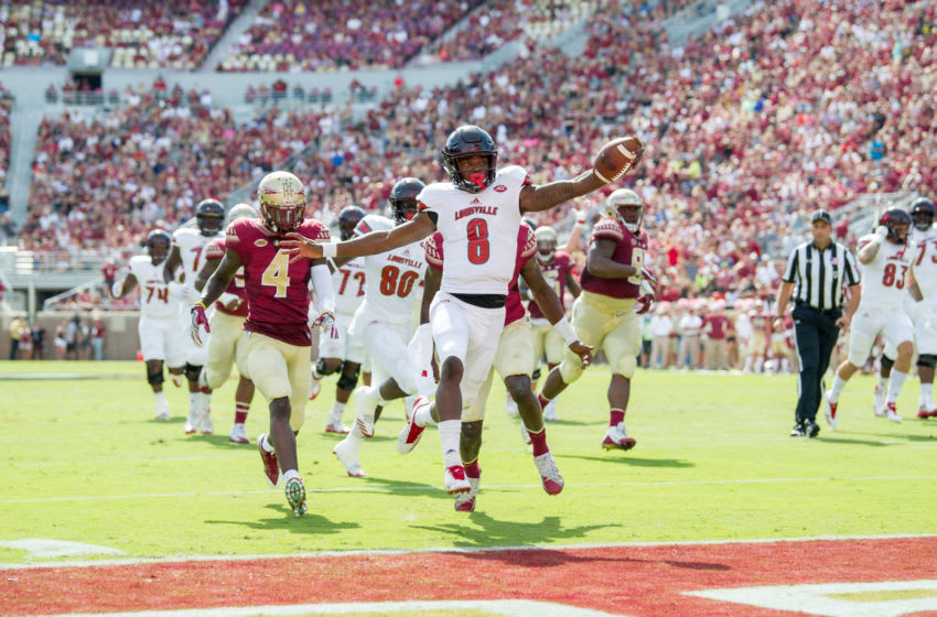 TALLAHASSEE, FL - OCTOBER 21: Quarterback Lamar Jackson #8 of the Louisville Cardinals runs the ball into the endzone for a touchdown during their game against the Florida State Seminoles at Doak Campbell Stadium on October 21, 2017 in Tallahassee, Florida. (Photo by Michael Chang/Getty Images)