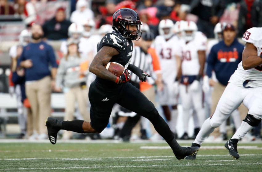 LOUISVILLE, KY - NOVEMBER 11: Jaylen Smith #9 of the Louisville Cardinals runs with the ball against the Virginia Cavaliers at Papa John's Cardinal Stadium on November 11, 2017 in Louisville, Kentucky. (Photo by Andy Lyons/Getty Images)