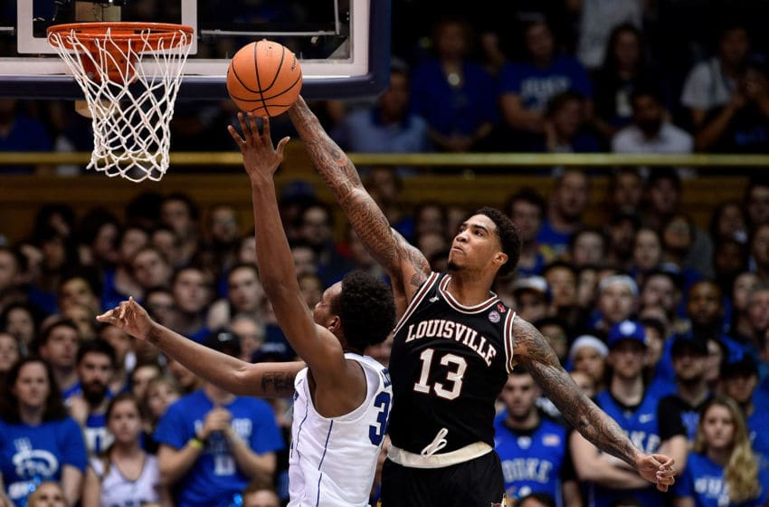 DURHAM, NC - FEBRUARY 21: Ray Spalding #13 of the Louisville basketball program blocks a shot by Wendell Carter Jr #34 of the Duke Blue Devils during their game at Cameron Indoor Stadium on February 21, 2018 in Durham, North Carolina. Duke won 82-56. (Photo by Grant Halverson/Getty Images)