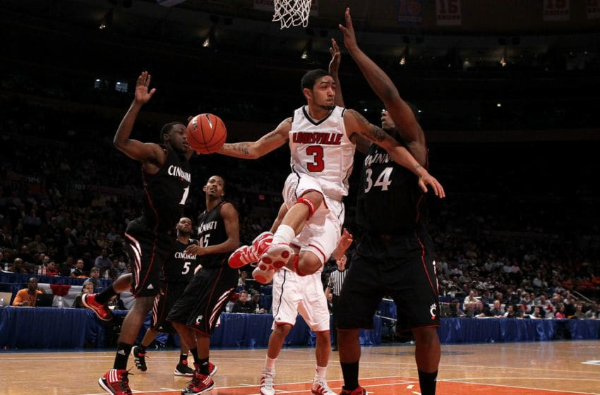 NEW YORK - MARCH 10: Peyton Siva #3 of the Louisville Cardinals looks to pass against Yancy Gates #34 of the Cincinnati Bearcats during the second round of 2010 NCAA Big East Tournament at Madison Square Garden on March 10, 2010 in New York City. (Photo by Jim McIsaac/Getty Images)
