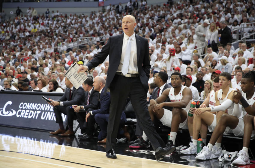 LOUISVILLE, KENTUCKY - DECEMBER 03: Chris Mack the head coach of the Louisville Cardinals gives instructions to his team against the Michigan Wolverines at KFC YUM! Center on December 03, 2019 in Louisville, Kentucky. (Photo by Andy Lyons/Getty Images)