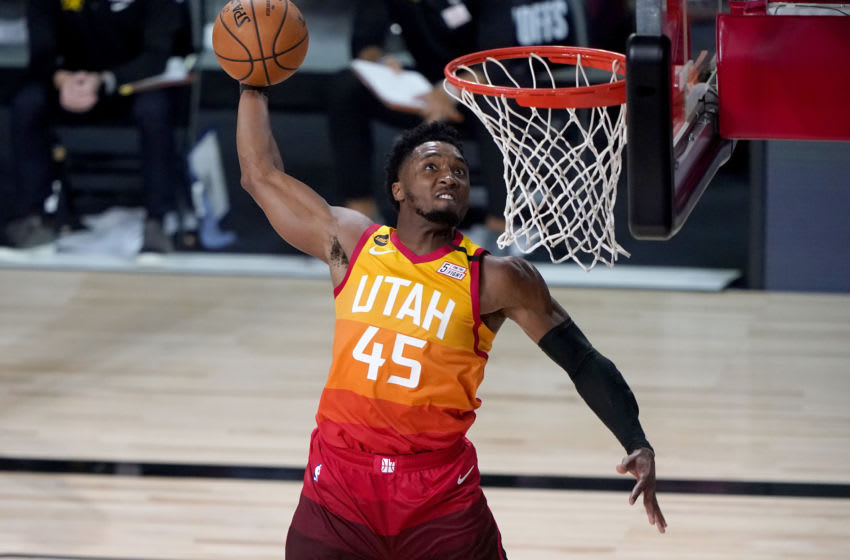LAKE BUENA VISTA, FLORIDA - AUGUST 21: Donovan Mitchell #45 of the Utah Jazz dunks against the Denver Nuggets during the second half of Game Three of first round playoffs at the AdventHealth Arena at the ESPN Wide World Of Sports Complex on August 21, 2020 in Lake Buena Vista, Florida. NOTE TO USER: User expressly acknowledges and agrees that, by downloading and or using this photograph, User is consenting to the terms and conditions of the Getty Images License Agreement. (Photo by Ashley Landis-Pool/Getty Images)