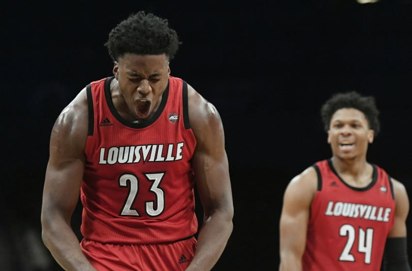 NEW YORK, NEW YORK - NOVEMBER 23: Steven Enoch #23 of the Louisville Cardinals and Dwayne Sutton #24 react during the first half of the game against Marquette Golden Eagles at the NIT Season Tip-Off Tournament at Barclays Center on November 23, 2018 in the Brooklyn borough of New York City. (Photo by Sarah Stier/Getty Images)