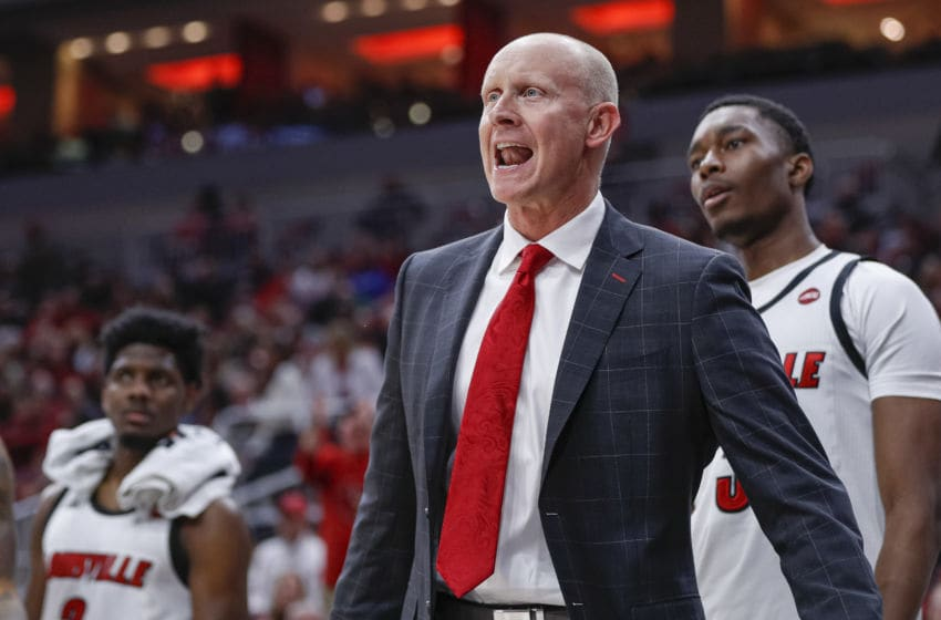 LOUISVILLE, KY - NOVEMBER 17: Head coach Chris Mack of the Louisville Cardinals speaks to players during the first half against the North Carolina Central Eagles at KFC YUM! Center on November 17, 2019 in Louisville, Kentucky. (Photo by Michael Hickey/Getty Images)