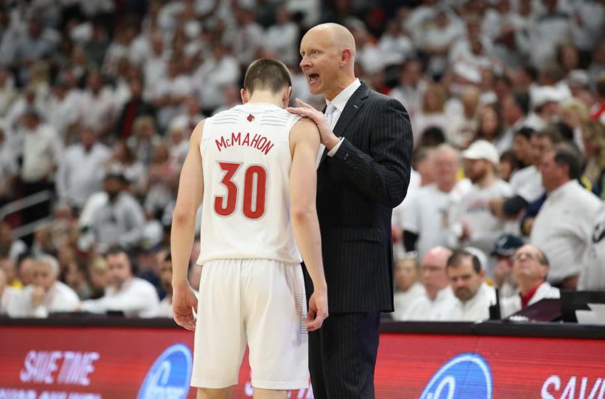 LOUISVILLE, KENTUCKY - DECEMBER 03: Chris Mack the head coach of the Louisville Cardinals gives instructions to Ryan McMahon #30 during the game against the Michigan Wolverines at KFC YUM! Center on December 03, 2019 in Louisville, Kentucky. (Photo by Andy Lyons/Getty Images)