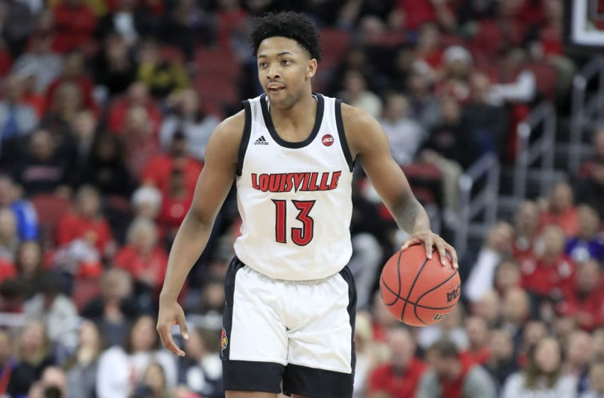 LOUISVILLE, KENTUCKY - DECEMBER 18: David Johnson #13 of the Louisville Cardinals dribbles the ball against the Miami-Ohio Redhawks at KFC YUM! Center on December 18, 2019 in Louisville, Kentucky. (Photo by Andy Lyons/Getty Images)