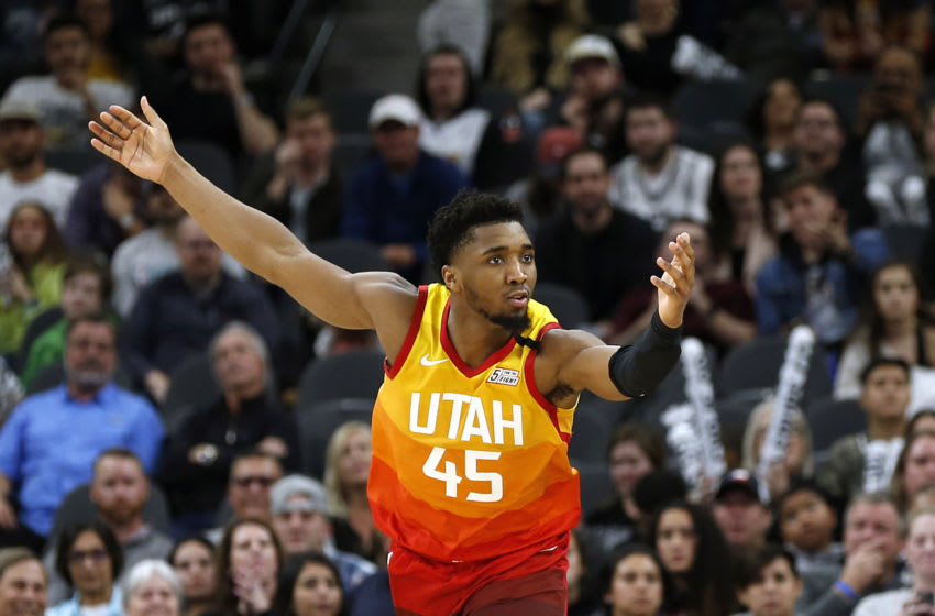 SAN ANTONIO, TX - JANUARY 29: Donovan Mitchell #45 of the Utah Jazz looks for a foul during second half action at AT&T Center on January 29, 2020 in San Antonio, Texas. San Antonio Spurs defeated the Utah Jazz 127-120. NOTE TO USER: User expressly acknowledges and agrees that , by downloading and or using this photograph, User is consenting to the terms and conditions of the Getty Images License Agreement. (Photo by Ronald Cortes/Getty Images)