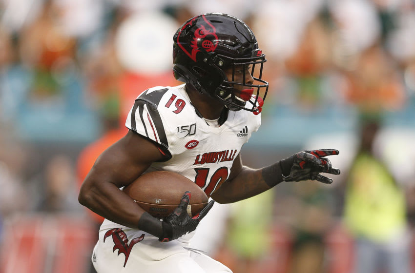 MIAMI, FLORIDA - NOVEMBER 09: Hassan Hall #19 of the Louisville Cardinals in action against the Miami Hurricanes during the first half at Hard Rock Stadium on November 09, 2019 in Miami, Florida. (Photo by Michael Reaves/Getty Images)