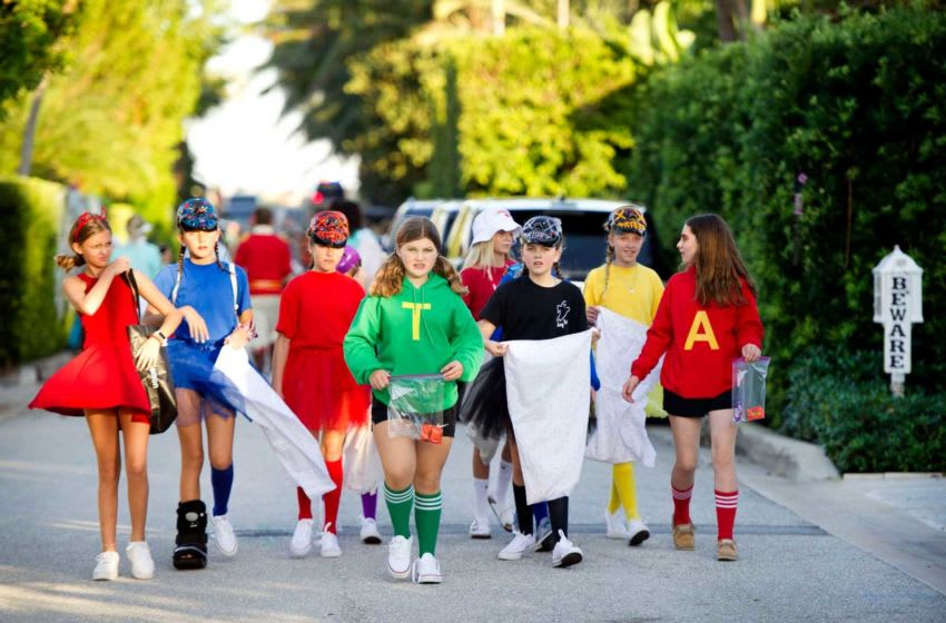 Hundreds of families in costumes walk Queen's Lane during Halloween trick-or-treating Thursday October 31, 2019 on the north end of Palm Beach.