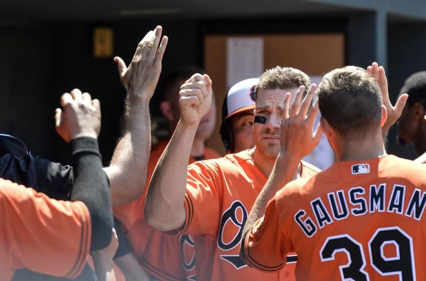 Jun 25, 2016; Baltimore, MD, USA; Baltimore Orioles first baseman Chris Davis (19) celebrates with teammates after scoring in the seventh inning against the Tampa Bay Rays at Oriole Park at Camden Yards. Baltimore Orioles defeated Tampa Bay Rays 5-0. Mandatory Credit: Tommy Gilligan-USA TODAY Sports