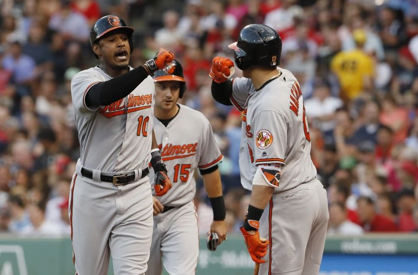 Jun 16, 2016; Boston, MA, USA; Baltimore Orioles center fielder Adam Jones (left) celebrates with shortstop Manny Machado (right) after hitting a two-run home run against the Boston Red Sox in the third inning at Fenway Park. Mandatory Credit: David Butler II-USA TODAY Sports