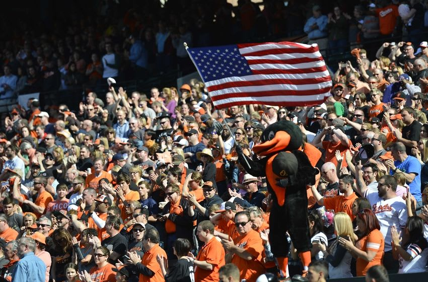 Apr 12, 2015; Baltimore, MD, USA; The Baltimore Orioles mascot waves the American flag during the seventh inning against the Toronto Blue Jays at Oriole Park at Camden Yards. The Blue Jays won 10-7. Mandatory Credit: Tommy Gilligan-USA TODAY Sports
