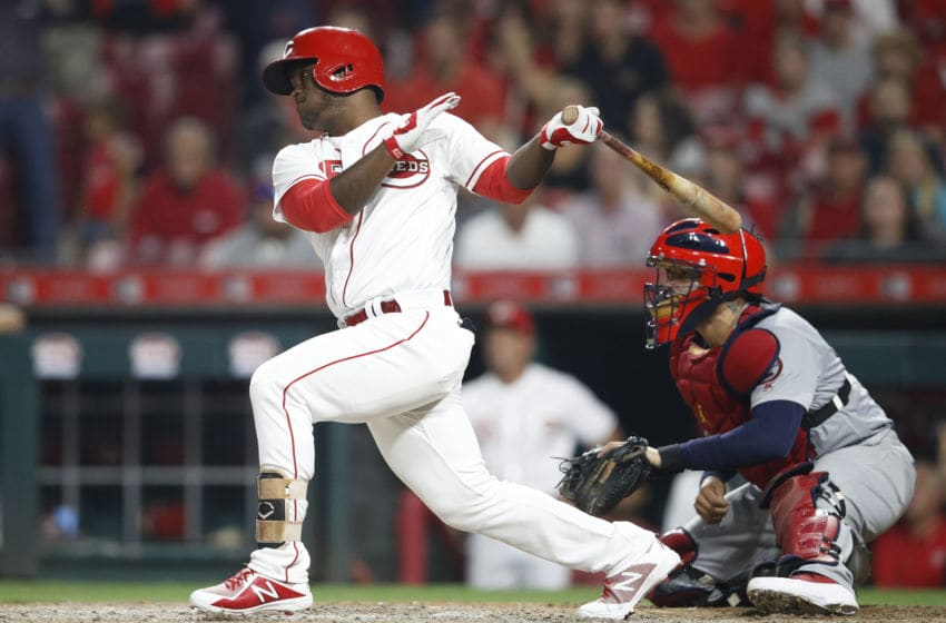 CINCINNATI, OH - JULY 23: Dilson Herrera #15 of the Cincinnati Reds hits a single to center field to drive in the game-winning run in the ninth inning against the St. Louis Cardinals during a game at Great American Ball Park on July 23, 2018 in Cincinnati, Ohio. The Reds won 2-1. (Photo by Joe Robbins/Getty Images)