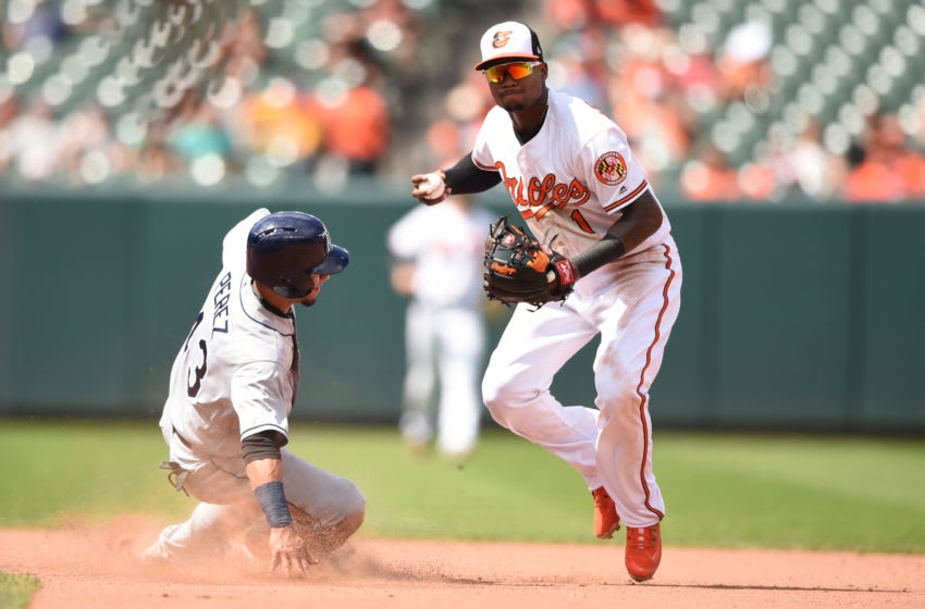 BALTIMORE, MD - JULY 29: Tim Beckham #1 of the Baltimore Orioles forces out Michael Perez #43 of the Tampa Bay Rays on a ball hit by Adeiny Hechavarria #11 (not pictured) in the seventh inning during a baseball game against the Baltimore Orioles at Oriole Park at Camden Yards on July 29, 2018 in Baltimore, Maryland. (Photo by Mitchell Layton/Getty Images)