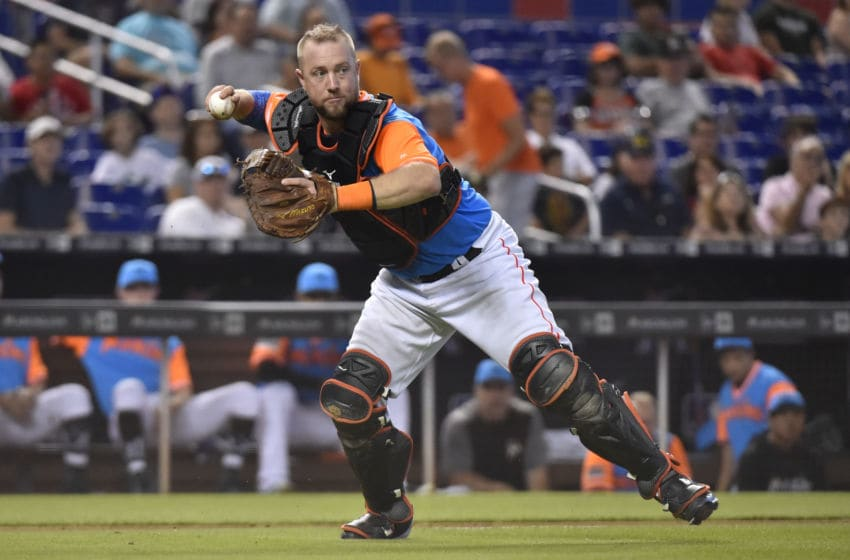 MIAMI, FL - AUGUST 26: Bryan Holaday #28 of the Miami Marlins throws towards first base during the fifth inning against the Atlanta Braves at Marlins Park on August 26, 2018 in Miami, Florida. All players across MLB will wear nicknames on their backs as well as colorful, non-traditional uniforms featuring alternate designs inspired by youth-league uniforms during Players Weekend. (Photo by Eric Espada/Getty Images)