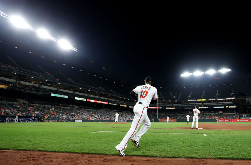 BALTIMORE, MD - SEPTEMBER 19: Adam Jones #10 of the Baltimore Orioles takes the field against the Toronto Blue Jays in the third inning at Oriole Park at Camden Yards on September 19, 2018 in Baltimore, Maryland. (Photo by Rob Carr/Getty Images)