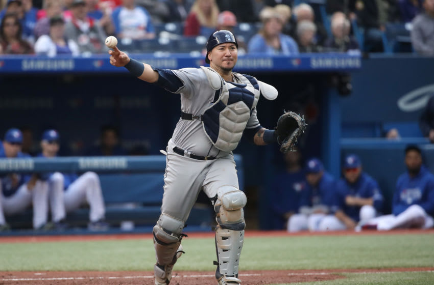 TORONTO, ON - SEPTEMBER 22: Jesus Sucre #45 of the Tampa Bay Rays throws out Rowdy Tellez #68 of the Toronto Blue Jays after Tellez struck out in the sixth inning during MLB game action at Rogers Centre on September 22, 2018 in Toronto, Canada. (Photo by Tom Szczerbowski/Getty Images)