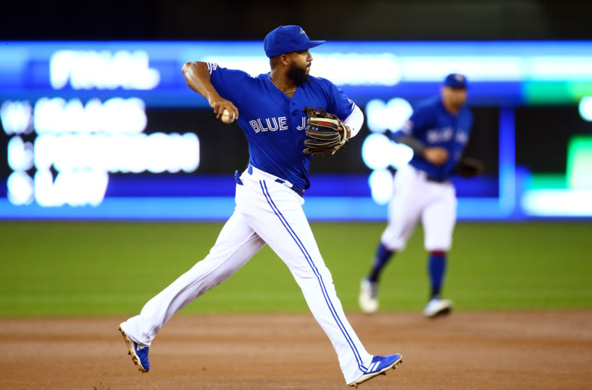 TORONTO, ON - APRIL 24: Richard Urena #7 of the Toronto Blue Jays throws to first for the final out of the first inning during a MLB game against the San Francisco Giants at Rogers Centre on April 24, 2019 in Toronto, Canada. (Photo by Vaughn Ridley/Getty Images)