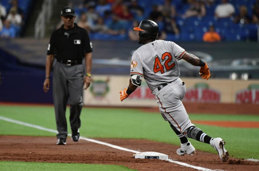 ST. PETERSBURG, FLORIDA - APRIL 16: Hanser Alberto #57 of the Baltimore Orioles rounds first after a hit against the Tampa Bay Rays at Tropicana Field on April 16, 2019 in St. Petersburg, Florida. (Photo by Julio Aguilar/Getty Images)
