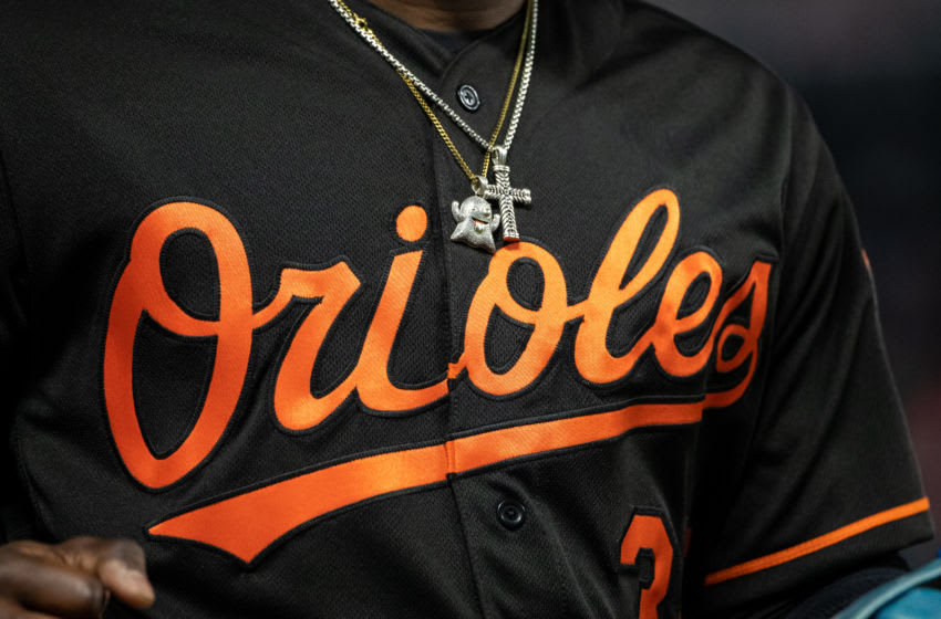 MINNEAPOLIS, MN - APRIL 26: The necklace and jersey of Dwight Smith Jr. #35 of the Baltimore Orioles against the Minnesota Twins on April 26, 2019 at the Target Field in Minneapolis, Minnesota. The Twins defeated the Orioles 6-1. (Photo by Brace Hemmelgarn/Minnesota Twins/Getty Images)