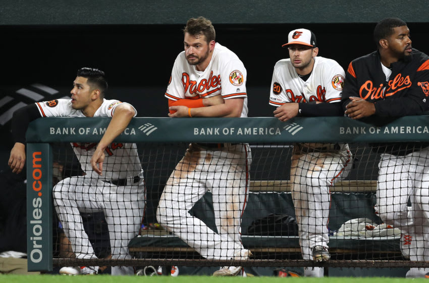 BALTIMORE, MARYLAND - MAY 08: Trey Mancini #16 of the Baltimore Orioles and teammates look on against the Boston Red Sox during the twelfth inning at Oriole Park at Camden Yards on May 08, 2019 in Baltimore, Maryland. (Photo by Patrick Smith/Getty Images)