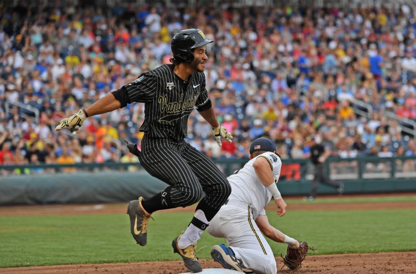 OMAHA, NE - JUNE 25: Austin Martin #16 of the Vanderbilt Commodores gets thrown out at first base in the third inning against the Michigan Wolverines during game two of the College World Series Championship Series on June 25, 2019 at TD Ameritrade Park Omaha in Omaha, Nebraska. (Photo by Peter Aiken/Getty Images)