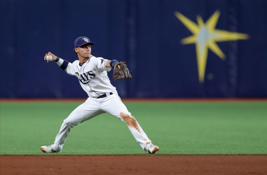 ST. PETERSBURG, FL - MAY 28: Andrew Velazquez #11 of the Tampa Bay Rays makes a throw to first in the fifth inning of a baseball game against the Toronto Blue Jays at Tropicana Field on May 28, 2019 in St. Petersburg, Florida. (Photo by Mike Carlson/Getty Images)