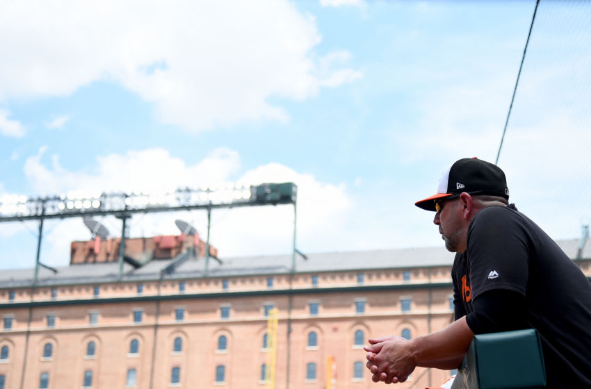 BALTIMORE, MD - JULY 14: Manager Brandon Hyde #18 of the Baltimore Orioles looks on during the game against the Tampa Bay Rays at Oriole Park at Camden Yards on July 14, 2019 in Baltimore, Maryland. (Photo by Will Newton/Getty Images)