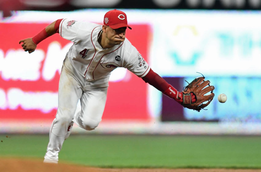 CINCINNATI, OH - JULY 19: Jose Iglesias #4 of the Cincinnati Reds tosses the ball to second base after fielding a ground ball in the sixth inning against the St. Louis Cardinals at Great American Ball Park on July 19, 2019 in Cincinnati, Ohio. All runners were safe on the play. (Photo by Jamie Sabau/Getty Images)