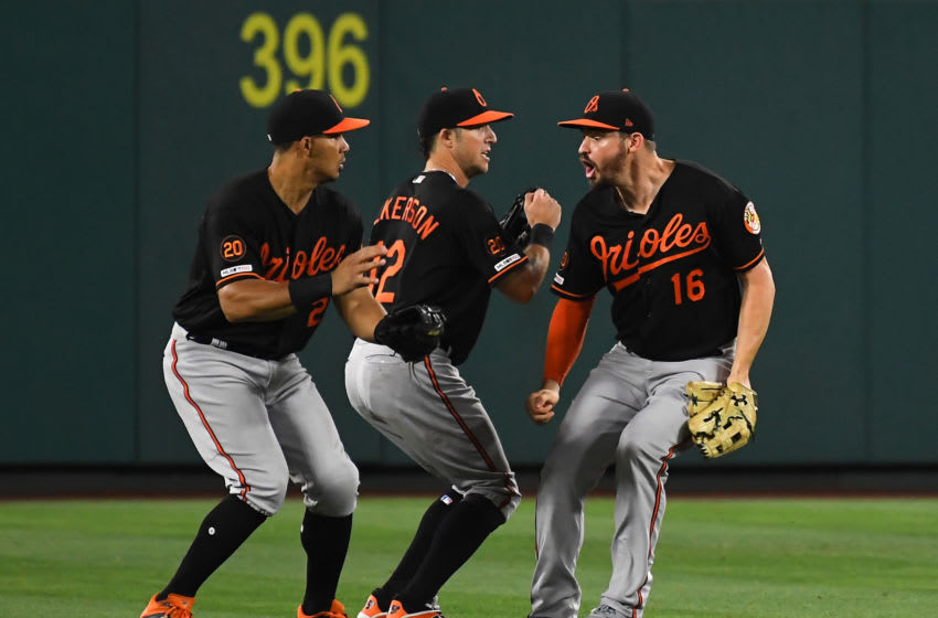 ANAHEIM, CA - JULY 26: Anthony Santander #25, Stevie Wilkerson #12 and Trey Mancini #16 of the Baltimore Orioles celebrate after the final out in the ninth inning against the Los Angeles Angels at Angel Stadium of Anaheim on July 26, 2019 in Anaheim, California. (Photo by Jayne Kamin-Oncea/Getty Images)