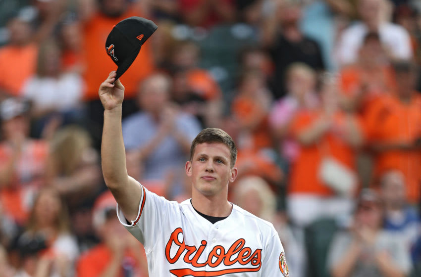 BALTIMORE, MARYLAND - JUNE 25: The 2019 top overall pick in the Major League Baseball draft, Adley Rutschman #35 of the Baltimore Orioles acknowledges the crowd during the fourth inning against the San Diego Padres at Oriole Park at Camden Yards on June 25, 2019 in Baltimore, Maryland. (Photo by Patrick Smith/Getty Images)