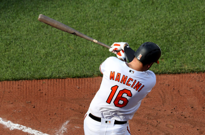 BALTIMORE, MARYLAND - JUNE 26: Trey Mancini #16 of the Baltimore Orioles swings at a pitch against the San Diego Padres at Oriole Park at Camden Yards on June 26, 2019 in Baltimore, Maryland. (Photo by Rob Carr/Getty Images)