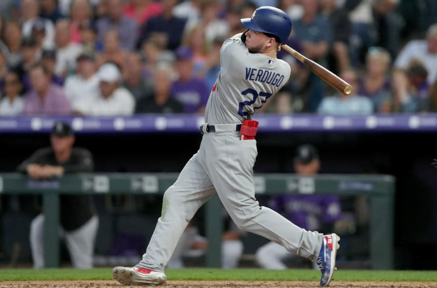 DENVER, COLORADO - JUNE 27: Alex Verdugo #27 of the Los Angeles Dodgers hits a single in the sixth inning against the Colorado Rockies at Coors Field on June 27, 2019 in Denver, Colorado. (Photo by Matthew Stockman/Getty Images)