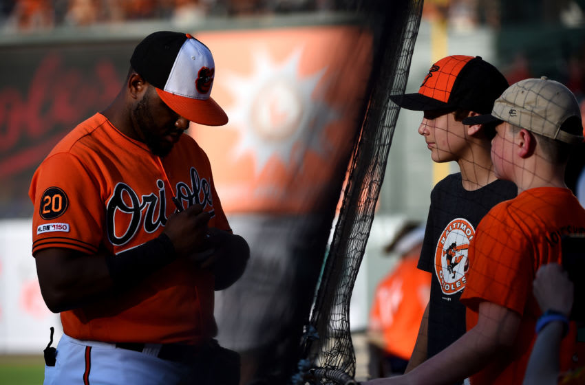 BALTIMORE, MD - JULY 13: Hanser Alberto #57 of the Baltimore Orioles autographs a baseball for fans prior to game two of a doubleheader against the Tampa Bay Rays at Oriole Park at Camden Yards on July 13, 2019 in Baltimore, Maryland. (Photo by Will Newton/Getty Images)