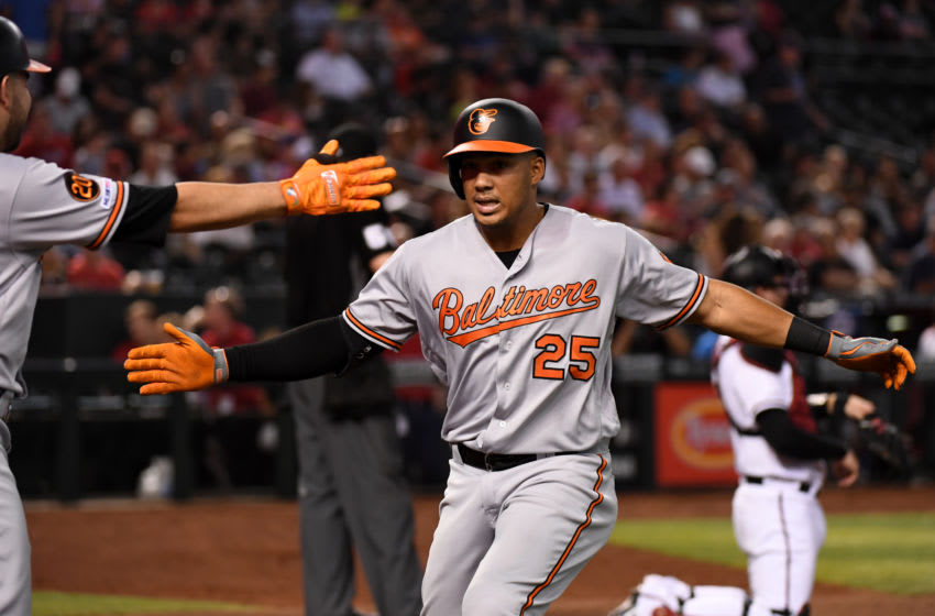PHOENIX, ARIZONA - JULY 24: Anthony Santander #25 of the Baltimore Orioles celebrates with teammate Renato Nunez #39 after hitting a solo home run off of Taylor Clarke #45 of the Arizona Diamondbacks during the fourth inning at Chase Field on July 24, 2019 in Phoenix, Arizona. (Photo by Norm Hall/Getty Images)