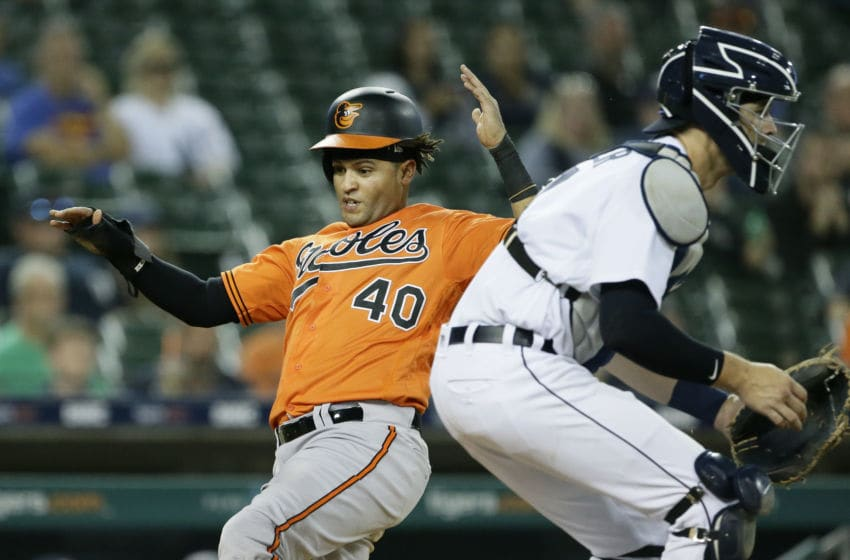 DETROIT, MI - SEPTEMBER 14: Mason Williams #40 of the Baltimore Orioles scores past catcher Grayson Greiner #17 of the Detroit Tigers on a single by Rio Ruiz to take a 4-3 lead during the 12th inning of the Baltimore Orioles at Comerica Park on September 14, 2019 in Detroit, Michigan. (Photo by Duane Burleson/Getty Images)