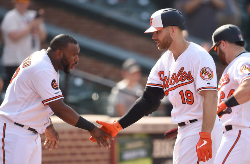 BALTIMORE, MD - SEPTEMBER 22: Chris Davis #19 of the Baltimore Orioles celebrates a home run in the eighth inning with Alberto Hanser #57 during a baseball game against the Seattle Mariners at Oriole Park at Camden Yards on September 22, 2019 in Baltimore, Maryland. (Photo by Mitchell Layton/Getty Images)