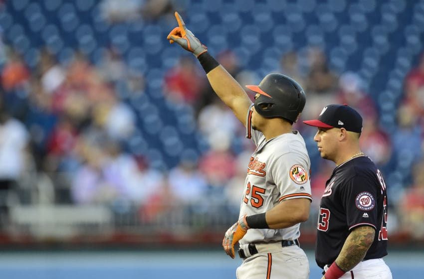 WASHINGTON, DC - AUGUST 27: Anthony Santander #25 of the Baltimore Orioles celebrates after hitting an RBI double scoring Hanser Alberto #57 in the first inning against the Washington Nationals during the interleague game at Nationals Park on August 27, 2019 in Washington, DC. (Photo by Patrick McDermott/Getty Images)