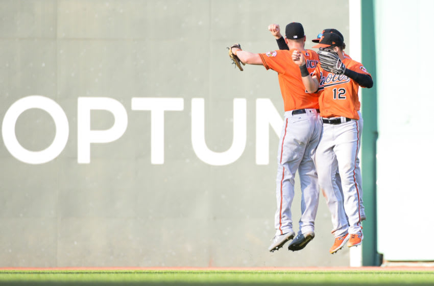 BOSTON, MA - SEPTEMBER 28: Trey Mancini #16, Austin Hays #21, and Stevie Wilkerson #12 of the Baltimore Orioles celebrate after beating the Boston Red Sox at Fenway Park on September 28, 2019 in Boston, Massachusetts. (Photo by Kathryn Riley/Getty Images)