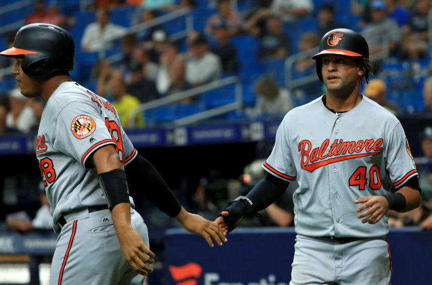 ST PETERSBURG, FLORIDA - SEPTEMBER 03: Mason Williams #40 of the Baltimore Orioles scores a run in the ninth inning during the first game of a doubleheader against the Tampa Bay Rays at Tropicana Field on September 03, 2019 in St Petersburg, Florida. (Photo by Mike Ehrmann/Getty Images)