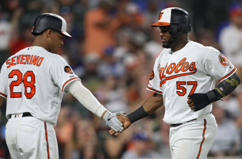 BALTIMORE, MARYLAND - SEPTEMBER 11: Hanser Alberto #57 of the Baltimore Orioles celebrates after scoring against the Los Angeles Dodgers during the sixth inning at Oriole Park at Camden Yards on September 11, 2019 in Baltimore, Maryland. (Photo by Patrick Smith/Getty Images)