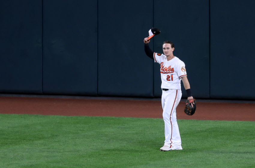 BALTIMORE, MARYLAND - SEPTEMBER 19: Austin Hays #21 of the Baltimore Orioles tips his hat to the crowd after robbing Vladimir Guerrero Jr. #27 of the Toronto Blue Jays (not pictured) of a home run in the fourth inning at Oriole Park at Camden Yards on September 19, 2019 in Baltimore, Maryland. (Photo by Rob Carr/Getty Images)