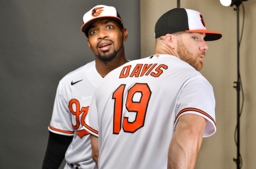 SARASOTA, FLORIDA - FEBRUARY 18: Mychal Givens #60 and Chris Davis #19 of the Baltimore Orioles pose during Photo Day at Ed Smith Stadium on February 18, 2020 in Sarasota, Florida. (Photo by Julio Aguilar/Getty Images)