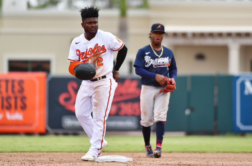 SARASOTA, FLORIDA - FEBRUARY 26: Dilson Herrera #2 of the Baltimore Orioles gets up slowly after a collision with Ozzie Albies #1 of the Atlanta Braves during the fifth inning of a spring training baseball game at Ed Smith Stadium on February 26, 2020 in Sarasota, Florida. (Photo by Julio Aguilar/Getty Images)