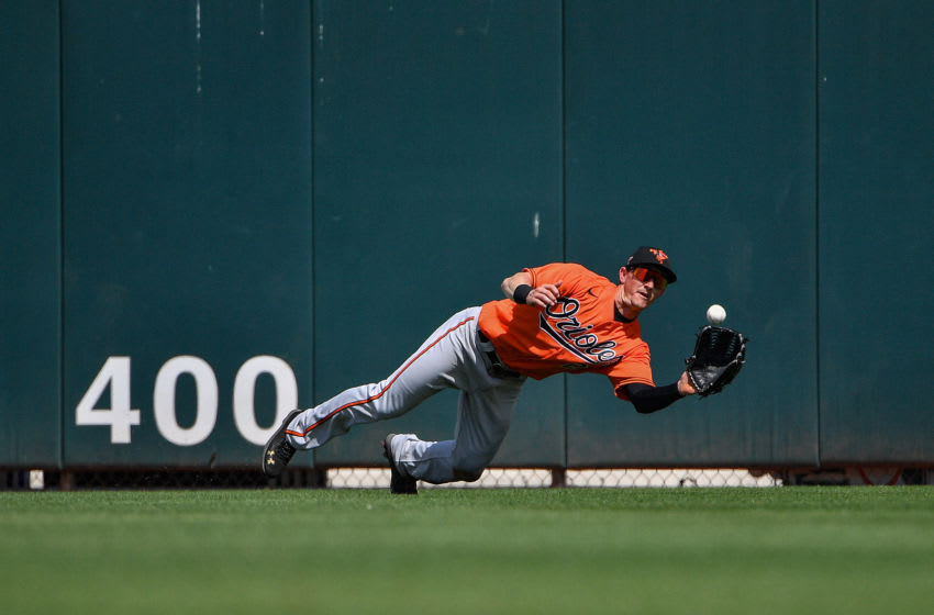 JUPITER, FLORIDA - MARCH 04: Austin Hays #21 of the Baltimore Orioles dives for the catch and out in the third inning of a spring training game against the Miami Marlins at Roger Dean Chevrolet Stadium on March 04, 2020 in Jupiter, Florida. (Photo by Mark Brown/Getty Images)