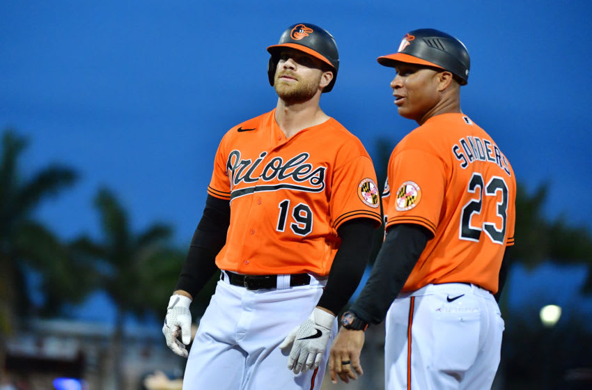 SARASOTA, FLORIDA - MARCH 10: Chris Davis #19 of the Baltimore Orioles stands with first base coach Anthony Sanders #23 after being walked during the sixth inning of a Grapefruit League spring training game against the Atlanta Braves at Ed Smith Stadium on March 10, 2020 in Sarasota, Florida. (Photo by Julio Aguilar/Getty Images)