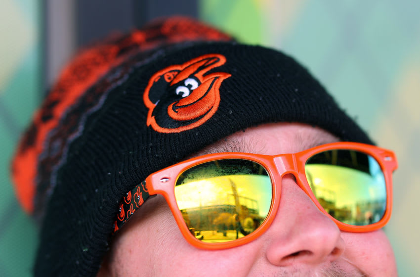 BALTIMORE, MARYLAND - MARCH 26: Oriole Park at Camden Yards is reflected in the sunglasses of Greg Miles as he and co-workers enjoyed lunch outside of the park on March 26, 2020 in Baltimore, Maryland. The Baltimore Orioles and New York Yankees Opening Day game scheduled for today, along with the entire MLB season, has been postponed due to the COVID-19 pandemic. (Photo by Rob Carr/Getty Images)